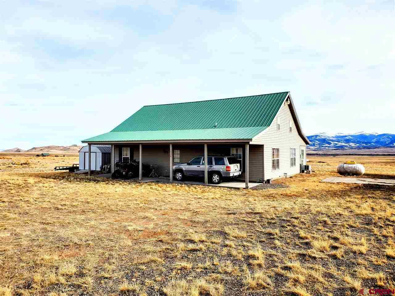 Photo of 338 Pinon Road, Del Norte, CO 81132 (MLS # 767664)