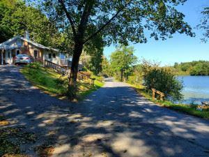 Photo of 23 ALGONQUIN RD, Sand Lake, NY 12196 (MLS # 202128879)