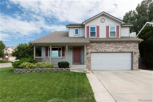 Photo of 13812 W 64th Place, Arvada, CO 80004 (MLS # 9727592)