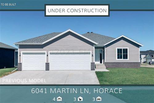 Photo of 6041 MARTIN Lane W, West Fargo, ND 58078 (MLS # 21-5748)