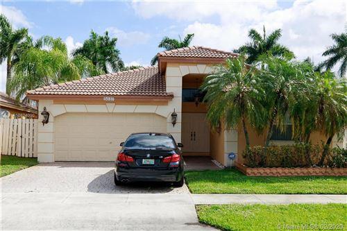 Photo of 5037 SW 130th Ter, Miramar, FL 33027 (MLS # A10824000)