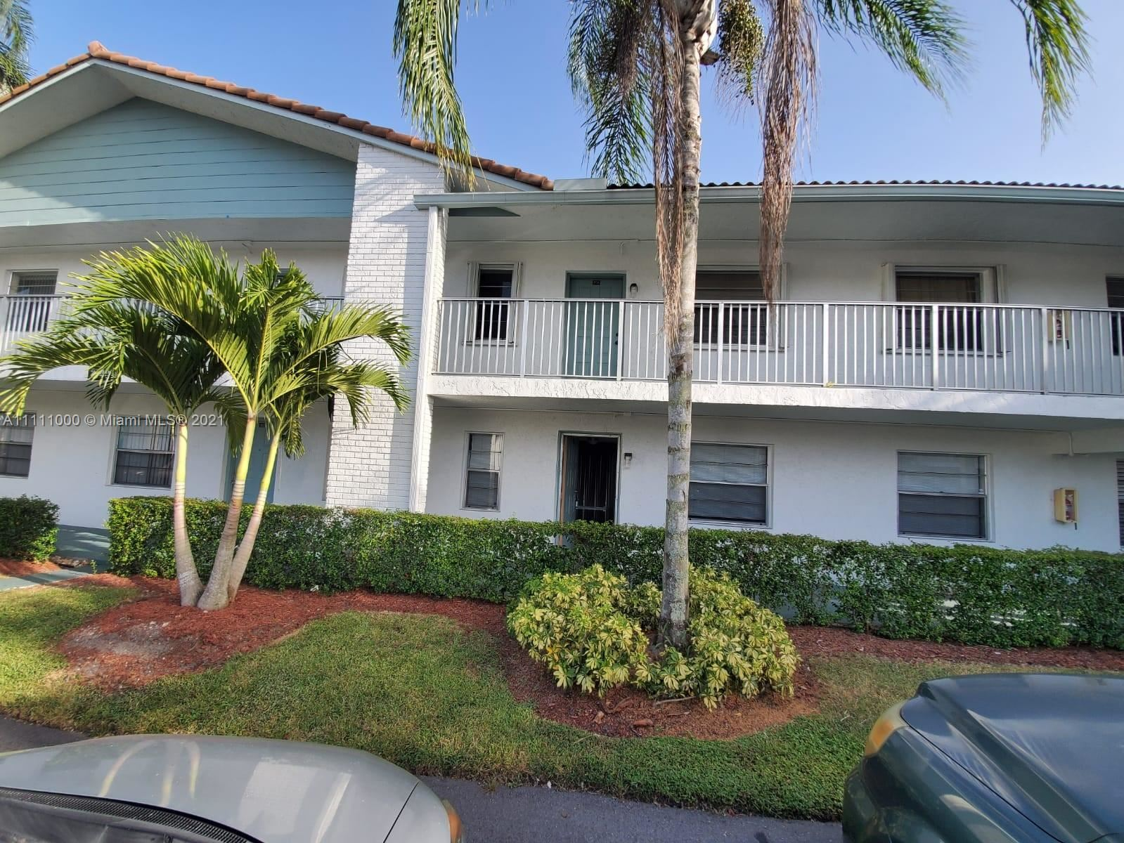 Photo of 2740 Forest Hills Blvd #104, Coral Springs, FL 33065 (MLS # A11111000)