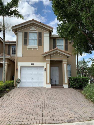Photo of 11826 SW 152nd Pl #11826, Miami, FL 33196 (MLS # A10932001)
