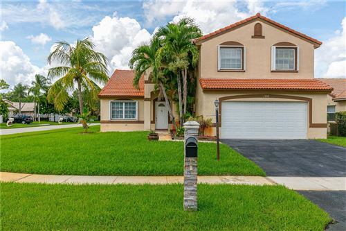 Photo of 100 NW 189th Ave, Pembroke Pines, FL 33029 (MLS # A11099001)