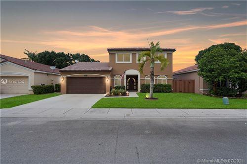 Photo of 1628 SW 108th Way, Davie, FL 33324 (MLS # A11077003)
