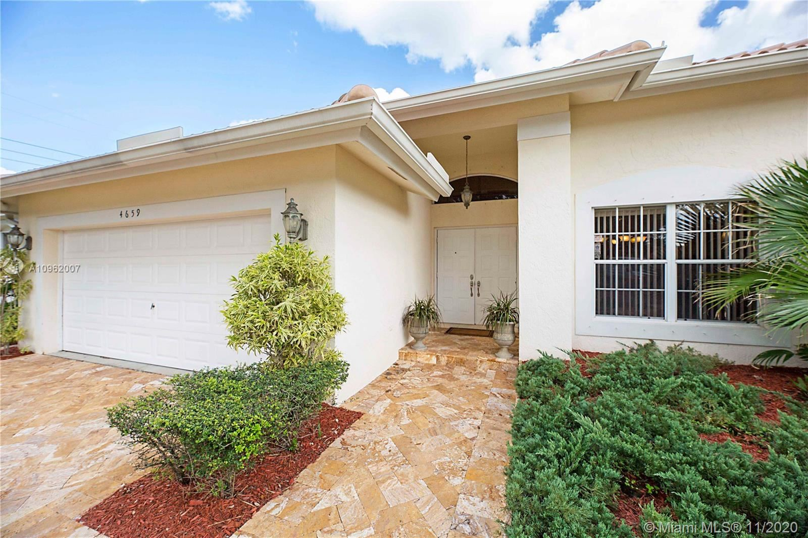 Photo of 4659 NW 99th Ter, Coral Springs, FL 33076 (MLS # A10962007)