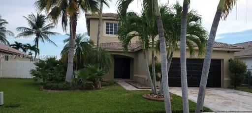 Photo of 20565 SW 2nd St, Pembroke Pines, FL 33029 (MLS # A11111011)