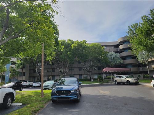 Photo of 901 Colony Point Cir #105, Pembroke Pines, FL 33026 (MLS # A11069013)