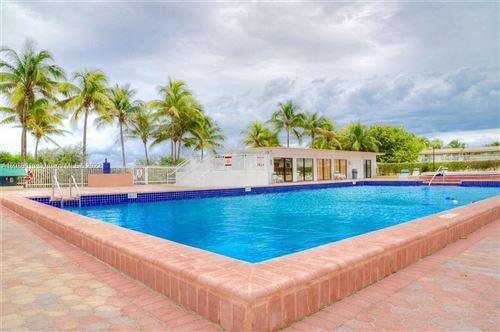 Photo of 5005 COLLINS AV #304, Miami Beach, FL 33140 (MLS # A10089015)