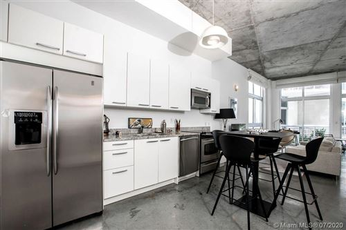 Photo of 2001 Meridian Ave #415, Miami Beach, FL 33139 (MLS # A10889017)