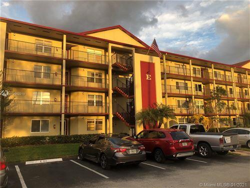 Photo of 901 SW 128th Ave #102E, Pembroke Pines, FL 33027 (MLS # A10982019)