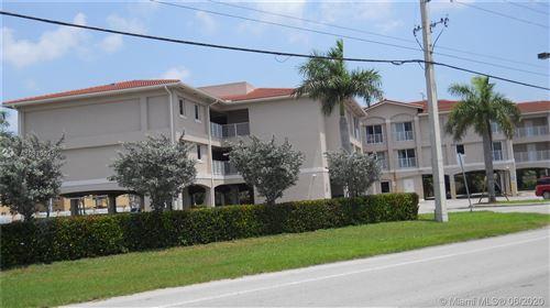 Photo of 9751 W Okeechobee Rd #215, Hialeah Gardens, FL 33016 (MLS # A10873021)