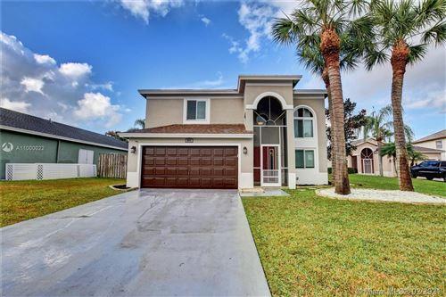 Photo of 8917 Aubrey Ln, Boynton Beach, FL 33472 (MLS # A11000022)