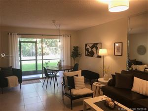 Photo of 900 SW 142nd Ave #106L, Pembroke Pines, FL 33027 (MLS # A10745024)