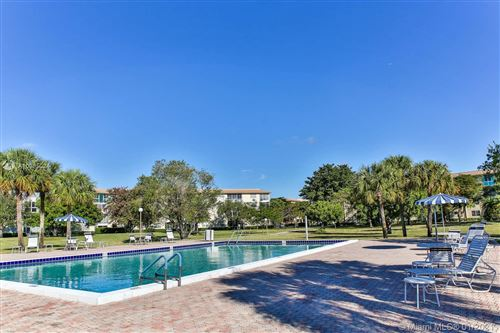 Photo of 1604 Abaco Dr #C2, Coconut Creek, FL 33066 (MLS # A10985024)