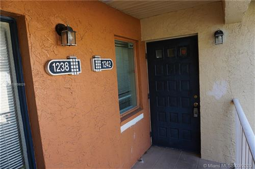Photo of 1242 The Pointe Dr #-, West Palm Beach, FL 33409 (MLS # A10838025)