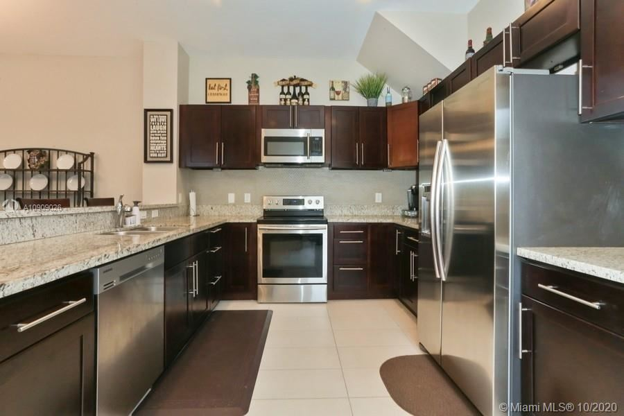 Photo of 1102 NE 18th Ave, Fort Lauderdale, FL 33304 (MLS # A10909026)