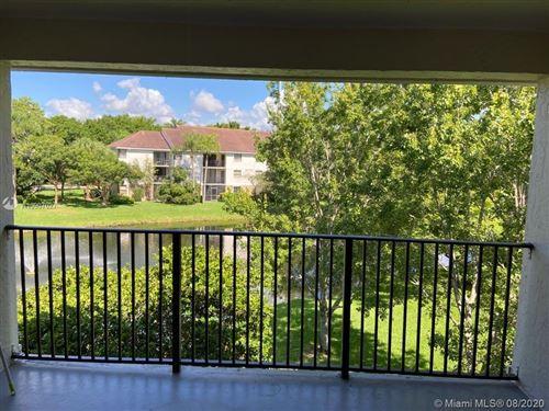 Photo of 10101 W Sunrise Boulevard #305, Plantation, FL 33322 (MLS # A10907027)
