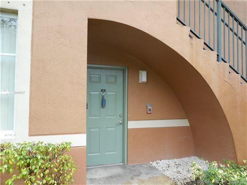 Photo of 8010 N Nob Hill Rd #101, Tamarac, FL 33321 (MLS # A10946027)
