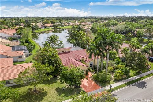 Photo of 5055 NW 100th Ter, Coral Springs, FL 33076 (MLS # A10835030)