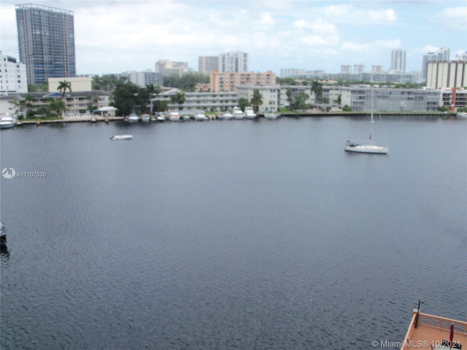 Photo of 410 Golden Isles Dr #701, Hallandale Beach, FL 33009 (MLS # A11107030)