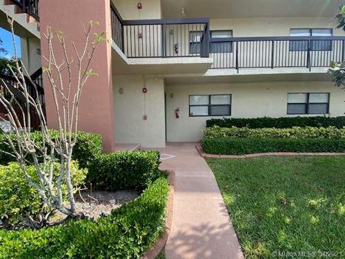 Photo of 1700 Hammock Blvd #107, Coconut Creek, FL 33063 (MLS # A11028031)