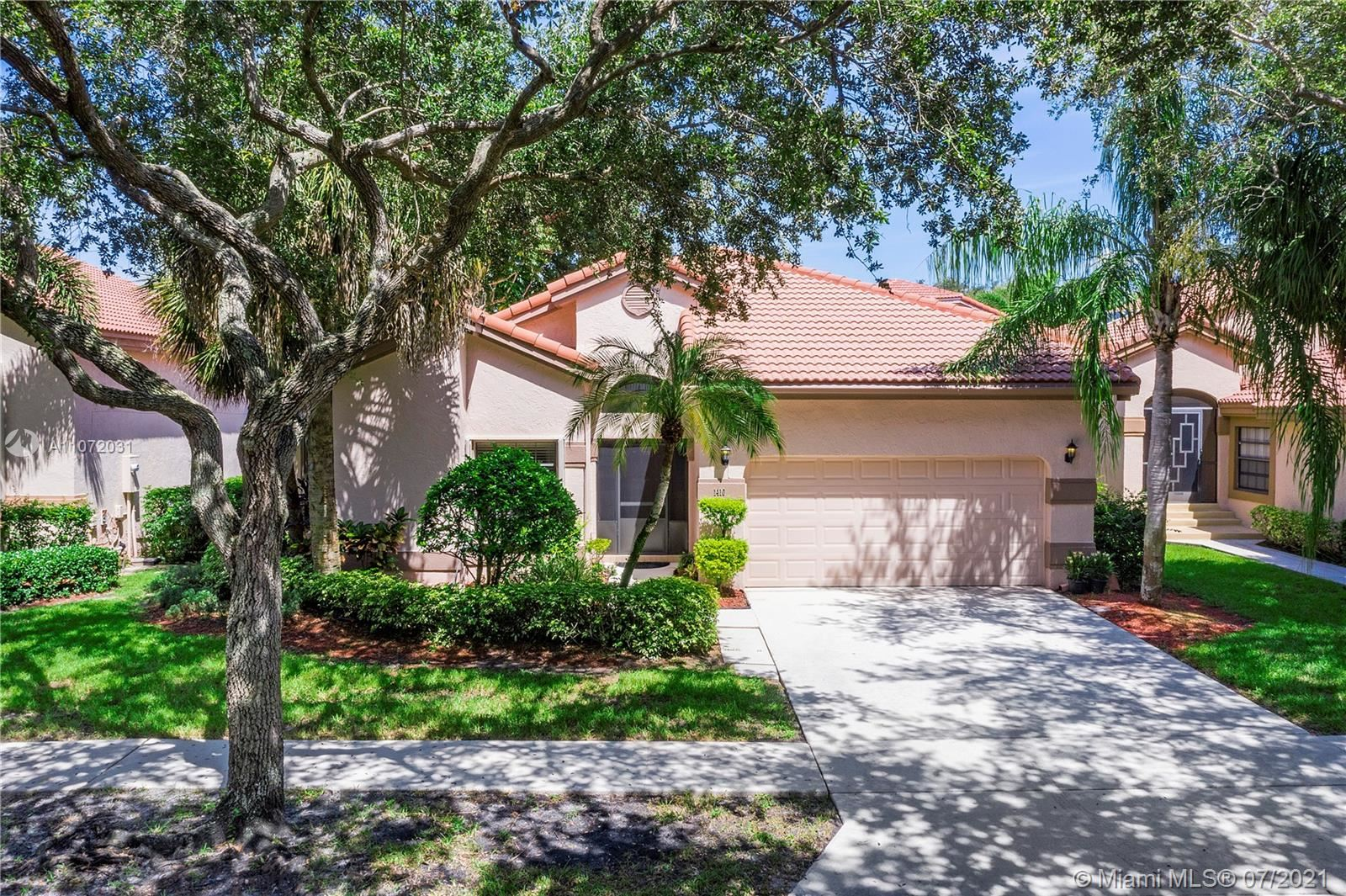 Photo of 1410 NW 104th Ave, Plantation, FL 33322 (MLS # A11072031)