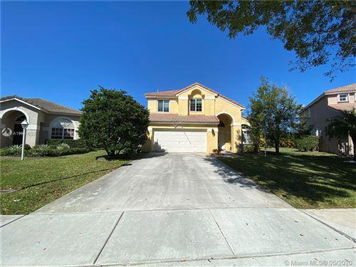Foto de inmueble con direccion 14295 NW 23rd St Pembroke Pines FL 33028 con MLS A10810032