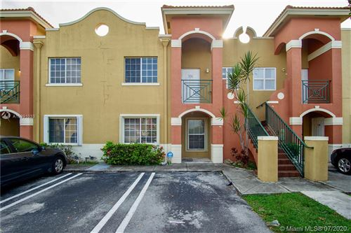 Photo of 15400 SW 134th Pl #406, Miami, FL 33177 (MLS # A10891033)
