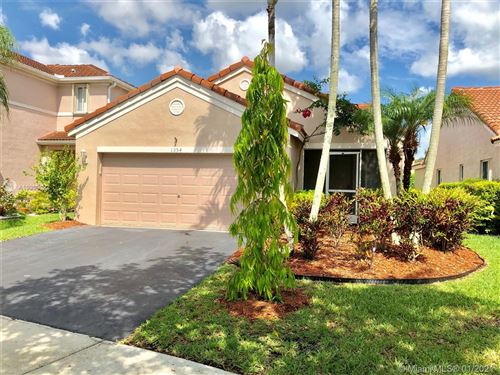 Photo of 1354 Plumosa Way, Weston, FL 33327 (MLS # A10909033)