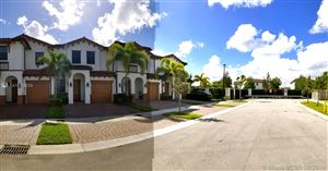 Photo of 8815 NW 102nd Ct, Doral, FL 33178 (MLS # A10733035)