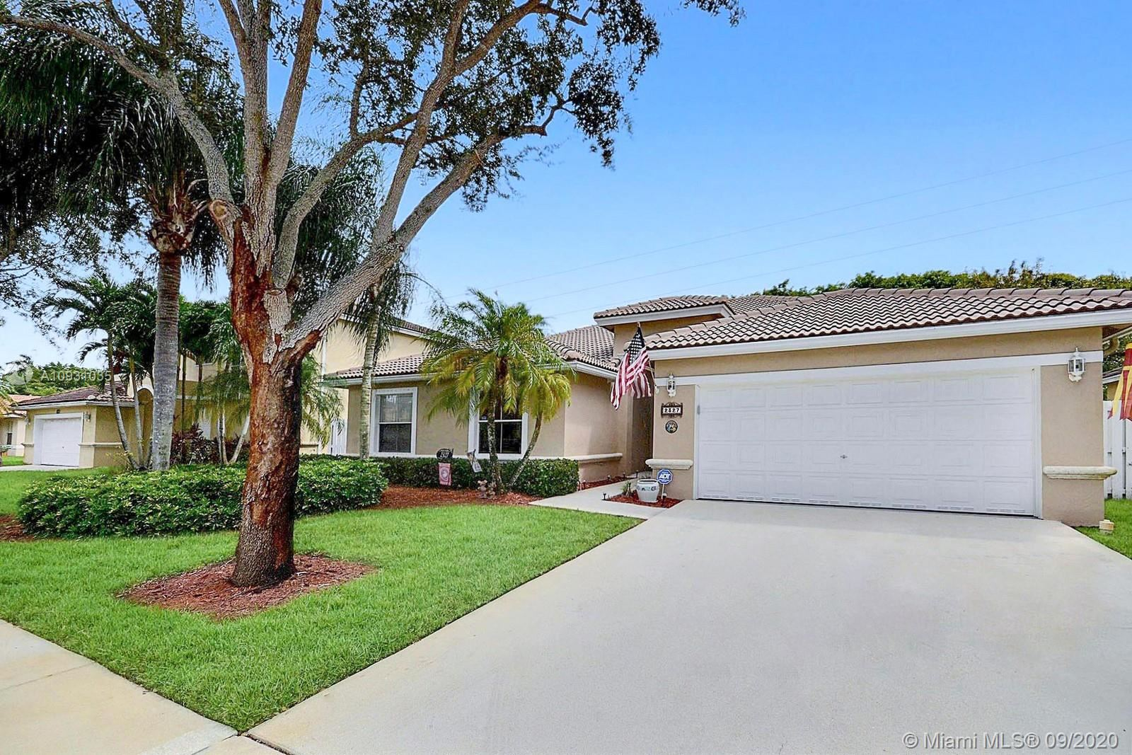 Photo of 2327 NW 184th Ter, Pembroke Pines, FL 33029 (MLS # A10931035)