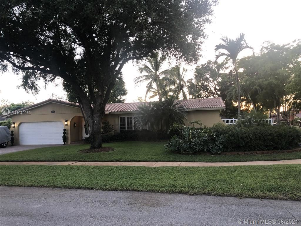 Photo of 1101 SW 71st Ave, Plantation, FL 33317 (MLS # A11040035)