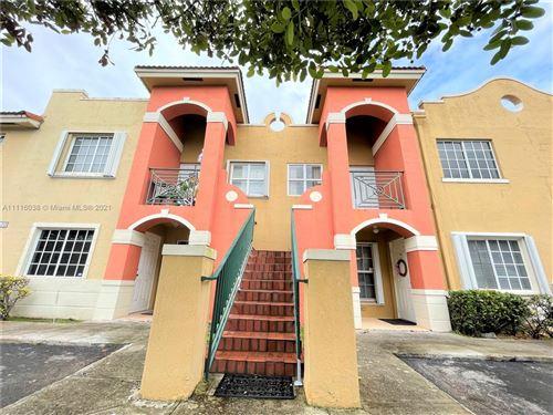 Photo of 15400 SW 134th Pl #408, Miami, FL 33177 (MLS # A11116038)