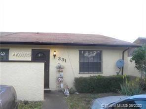 Photo of 331 NW 43rd St, Deerfield Beach, FL 33064 (MLS # A10880039)