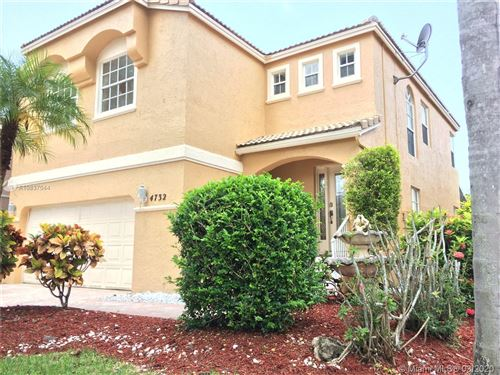 Photo of 4732 NW 115th Ter, Coral Springs, FL 33076 (MLS # A10837044)