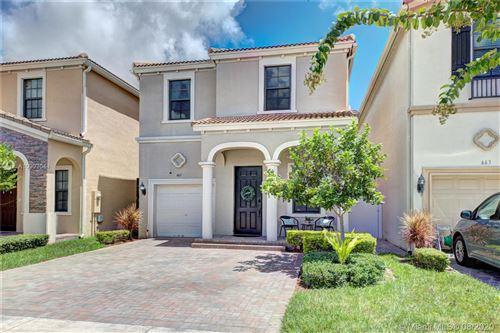 Photo of 661 NE 191st Street, Miami, FL 33179 (MLS # A10903044)