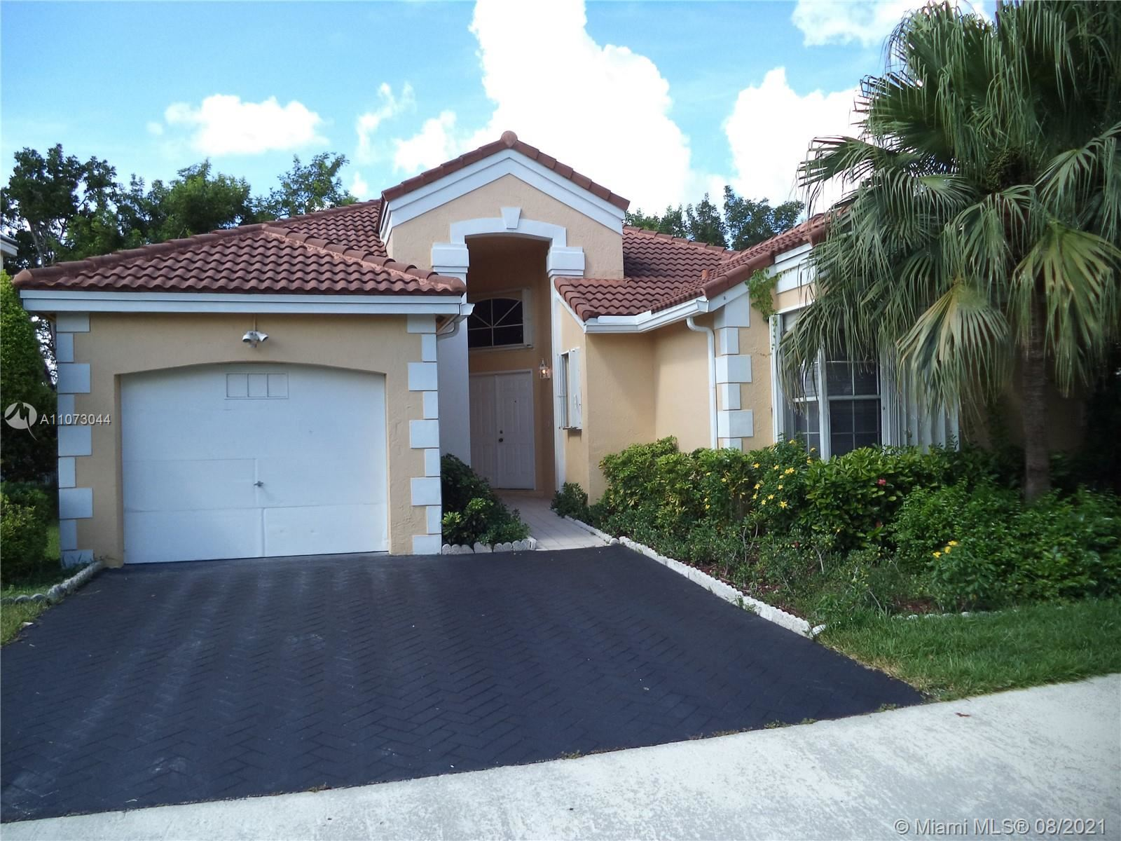 Photo of 583 Bedford Ave, Weston, FL 33326 (MLS # A11073044)