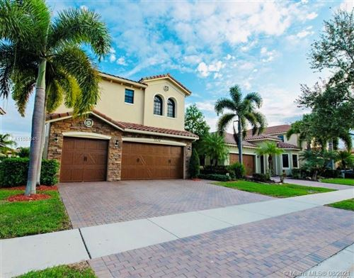 Photo of 7534 NW 113th Ave, Parkland, FL 33076 (MLS # A11084045)