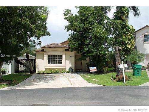 Photo of 14130 SW 151st Ct, Miami, FL 33196 (MLS # A10941047)
