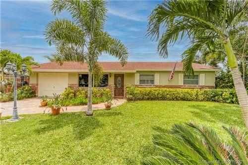 Photo of 342 E Shadyside Cir, West Palm Beach, FL 33415 (MLS # A11068048)