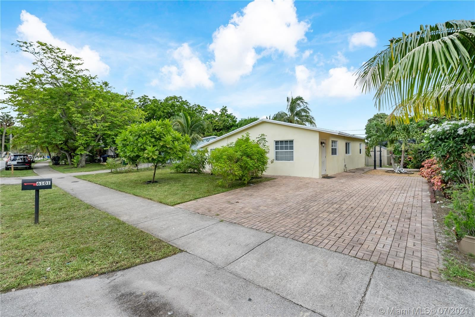Photo of 6101 NW 42nd Ave, North Lauderdale, FL 33319 (MLS # A11070048)