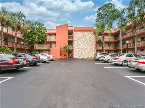 Photo of 3100 Holiday Springs Blvd #307, Margate, FL 33063 (MLS # A10957049)