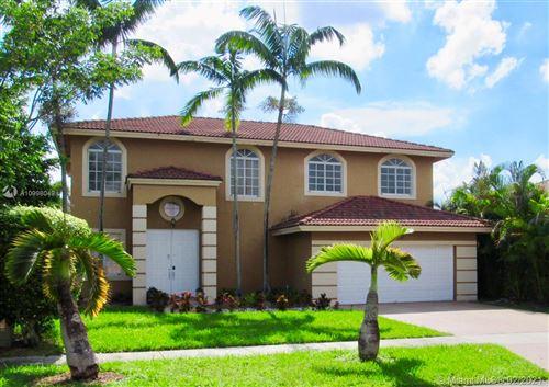 Photo of 14201 SW 161st Pl, Miami, FL 33196 (MLS # A10998049)