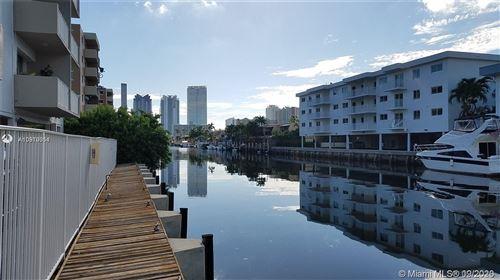 Photo of 3716 NE 168th St #402, North Miami Beach, FL 33160 (MLS # A10910054)