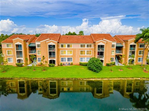 Photo of 4840 N State Road 7 #6106, Coconut Creek, FL 33073 (MLS # A10907055)