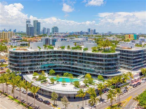 Photo of 1 Collins Ave #402, Miami Beach, FL 33139 (MLS # A11024058)