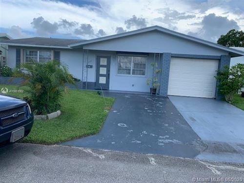 Photo of 4206 NW 47th St, Tamarac, FL 33319 (MLS # A10881062)