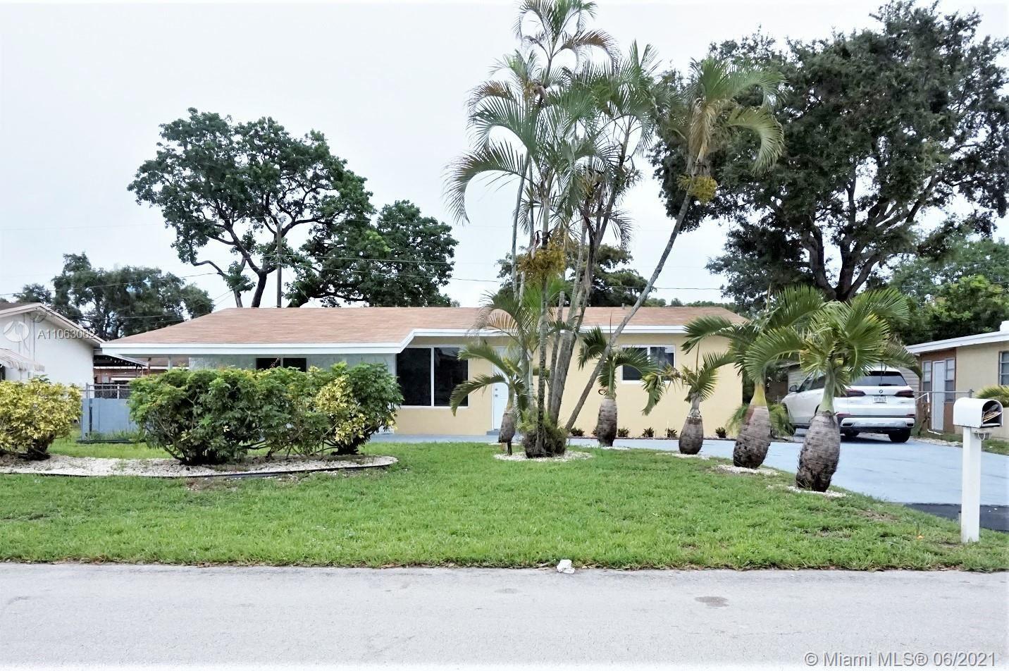 Photo of 5750 SW 54th Ave, Davie, FL 33314 (MLS # A11063062)