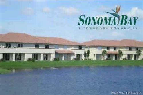 Photo of 3635 Sonoma Dr #-, Riviera Beach, FL 33404 (MLS # A11057063)